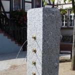 Umgestaltung des Dorfplatzes in Bensheim Gronau, Bau eines Granitbrunnens, 2002, Planung AMB